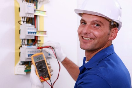 Electrician testing fuses